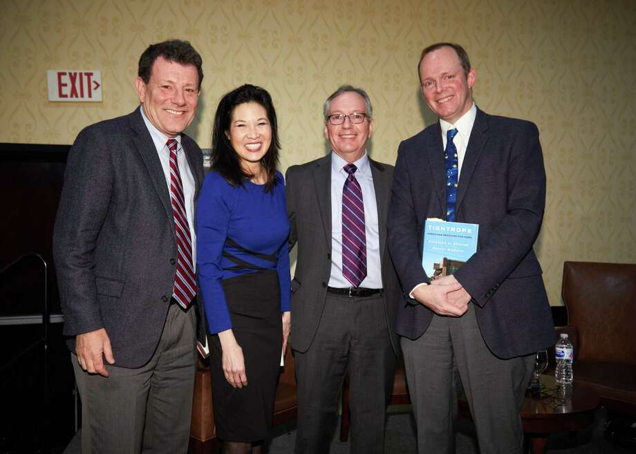 Bestselling authors Nicholas Kristof and Sheryl WuDunn, with Family Centers President and CEO Bob Arnold and Greenwich Time editorial page editor John Breunig at the 'Titan Series' breakfast to benefit Family Centers of Greenwich. Photo: Contributed / Chi Chi Ubina