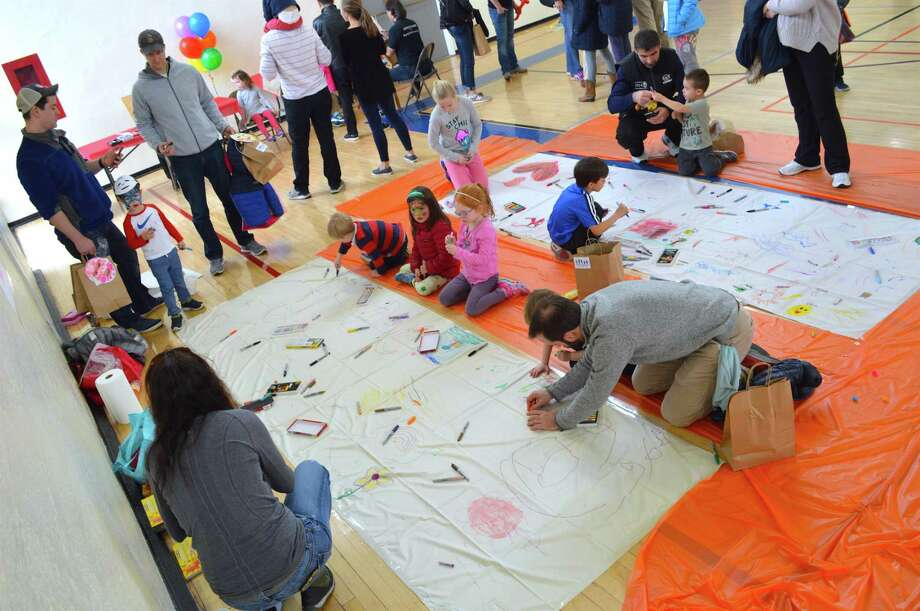 Visitors took part in making murals at a previous Community Art Festival at Town Hall. Photo: Jarret Liotta / For Hearst Connecticut Media / Darien News Freelance
