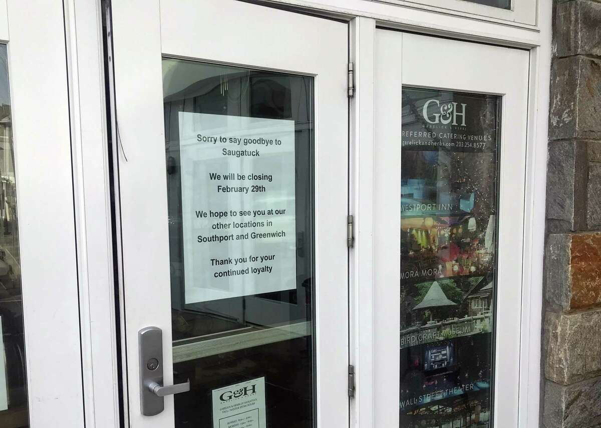 A sign on the entrance to Garelick & Herbs on Riverside Avenue states the business will close on Feb. 28. Taken Feb. 20, 2020 in Westport, Conn.