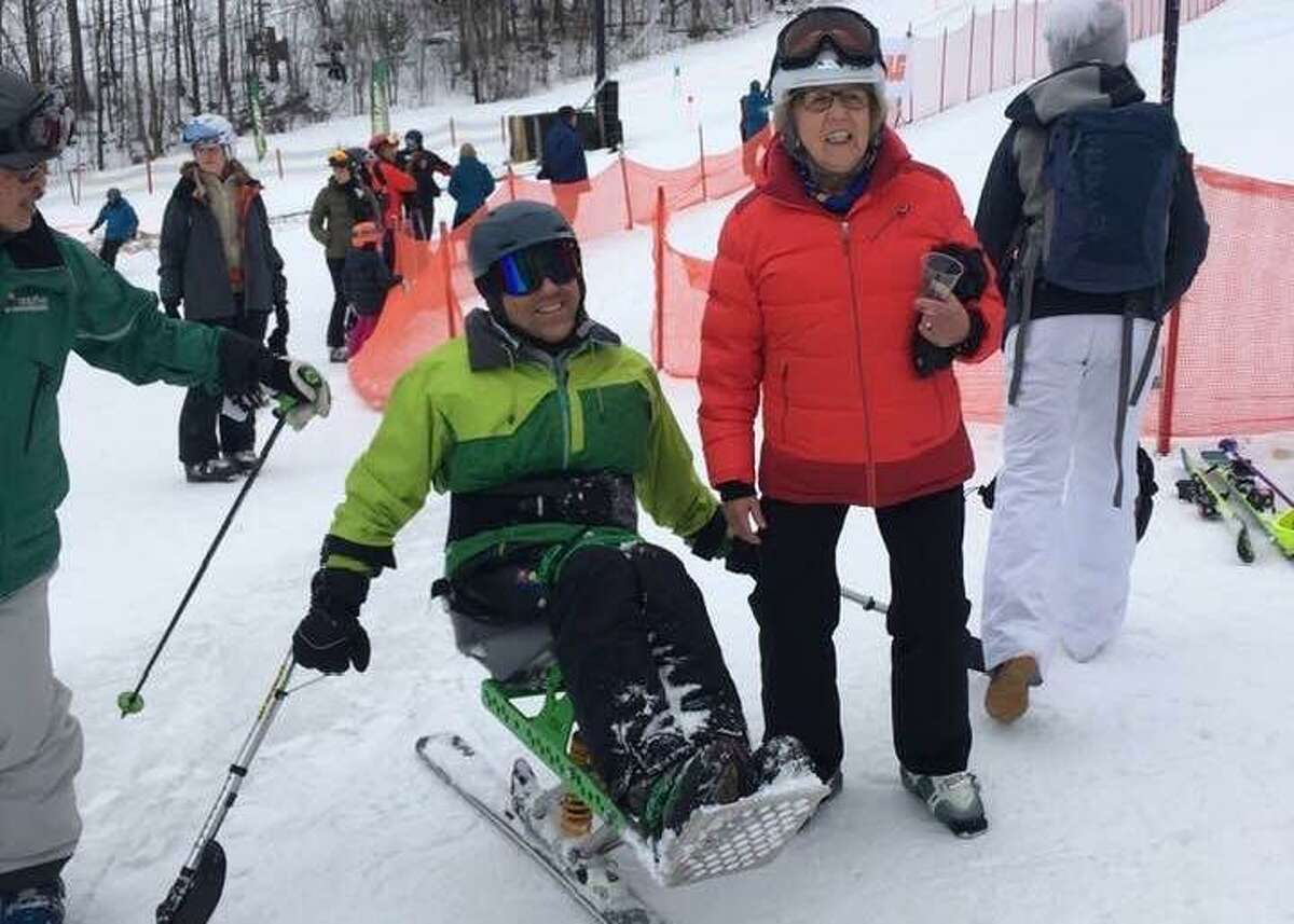 Jose Morales of Monroe, Conn., is greeted by Lissi Gray of Wilton after a run down Windham Mountain on a monoski in 2019. Morales, who was paralyzed in a ladder accident, will ski in the 20th Michael Gray Memorial Ski and Snowboard Race on March 7. Lissi Gray was Michael Gray's mother, for whom the race is named.