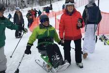 Jose Morales of Trumbull, Conn., is greeted by Lissi Gray of Wilton after a run down Windham Mountain on a monoski in 2019. Morales, who was paralyzed in a ladder accident, will ski in the 20th Michael Gray Memorial Ski and Snowboard Race on March 7. Lissi Gray was Michael Gray's grandmother, for whom the race is named.