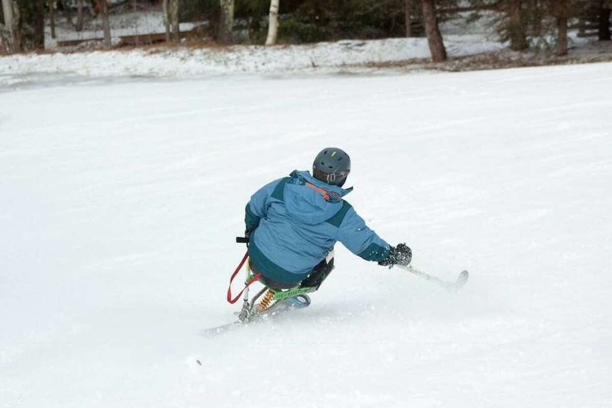 Jose Morales of Monroe, Conn., heads down Windham Mountain in 2019 on a monoski in Windham, N.Y. Morales was paralyzed in a ladder accident.
