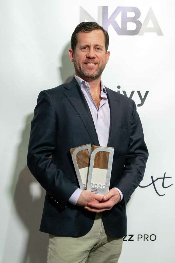 Peter Deane of New Canaan's DEANE, Inc., with the Luxury Kitchen Recycling Award the firm won at the Kitchen Bath and Industry Show, (KBIS 2020), in Las Vegas, Nevada. Photo: DEANE, Inc. / Contributed Photo / New Canaan Advertiser Contributed