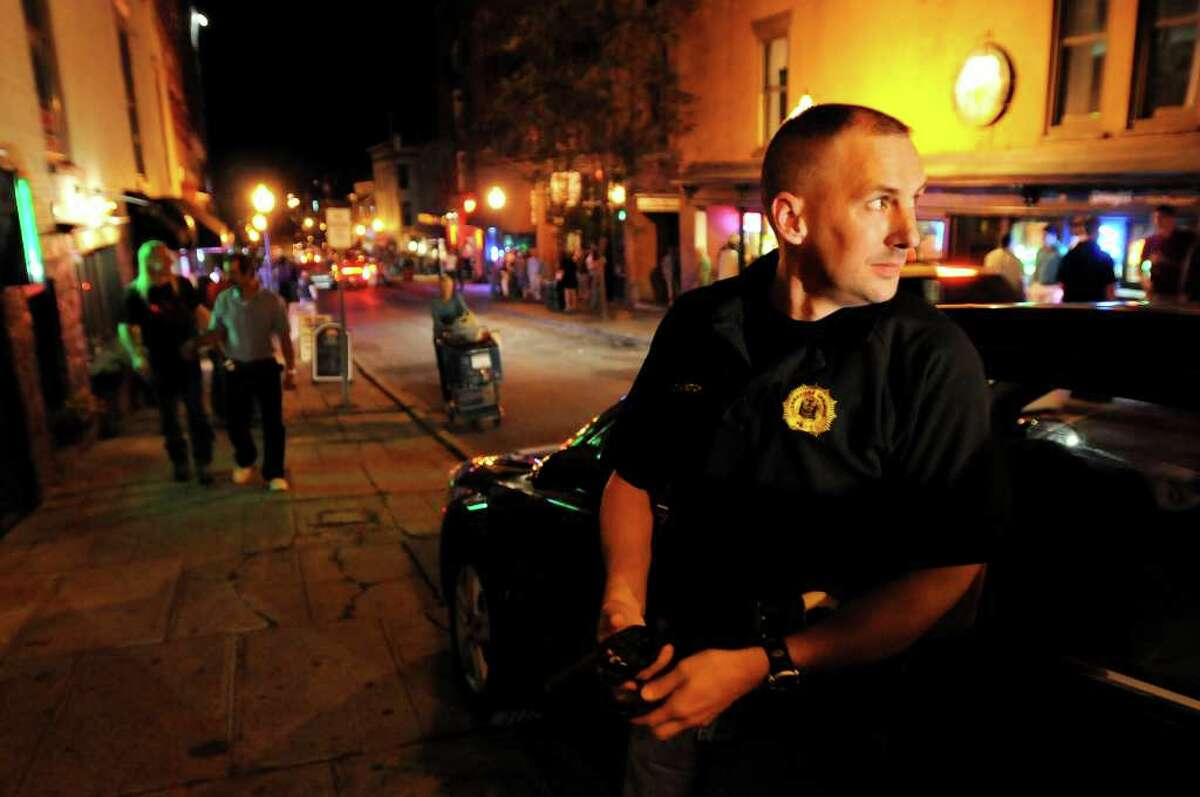 Lt. Greg Veitch keeps an eye on Caroline Street in Saratoga Springs on a Friday night in August. (Cindy Schultz / Times Union)