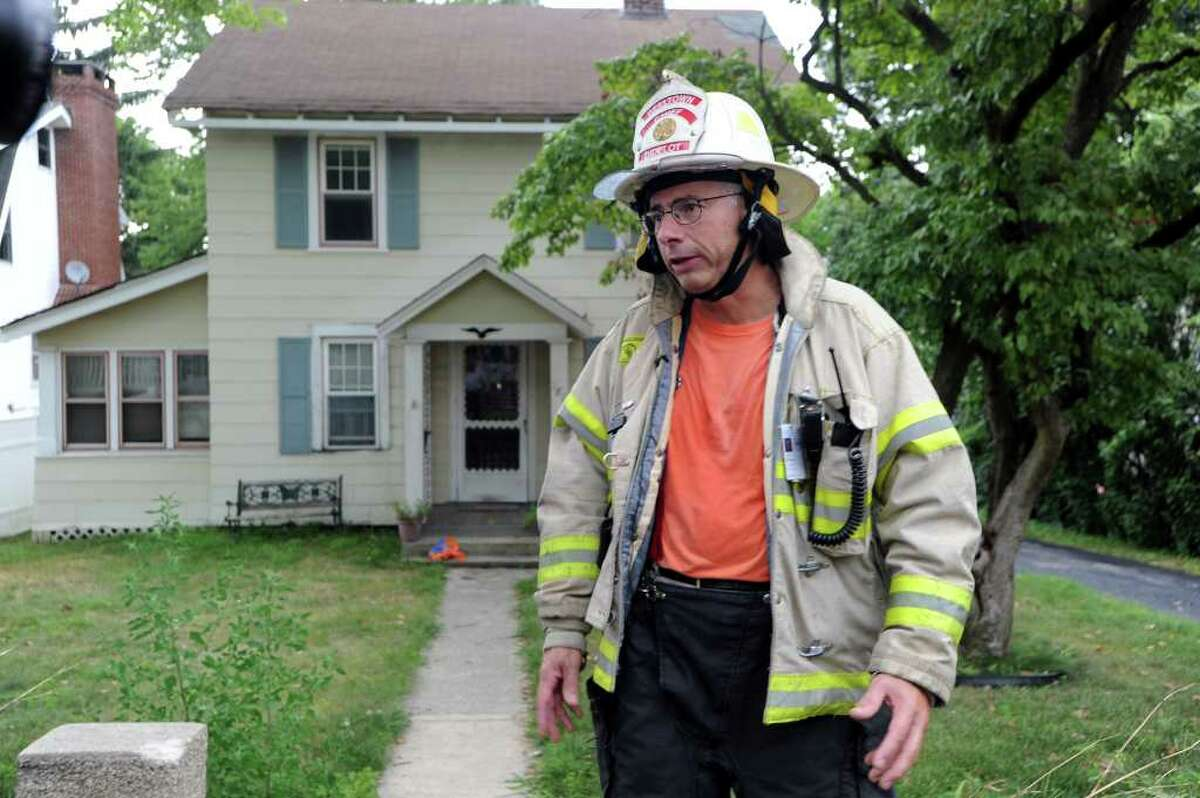 Belltown Chief John Didelot discusses a structure fire at 181 Toms Road after the Belltown Fire Department responded to a call there late Monday afternoon, August 16, 2010. Didelot said the fire appeared to be electrical starting in the kitchen near the stove damaging the surrounding cabinets. Although most of the damage was internal and due to smoke the gas and electricity feeding the building had to be cut resulting in the residents being displaced. There were no injuries. Stamford Fire and Rescue and Turn of the River were also on the scene.