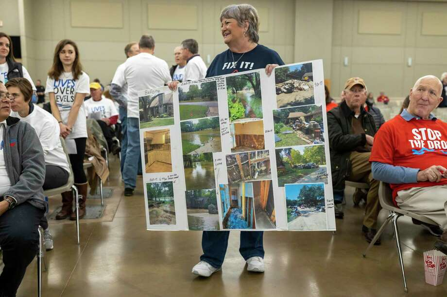 A Kingwood resident shows images of her home during tropical storm Imelda at the Lone Star Convention Center in Conroe, Thursday, Feb. 20, 2020. Photo: Gustavo Huerta, Houston Chronicle / Staff Photographer / Houston Chronicle ? 2020