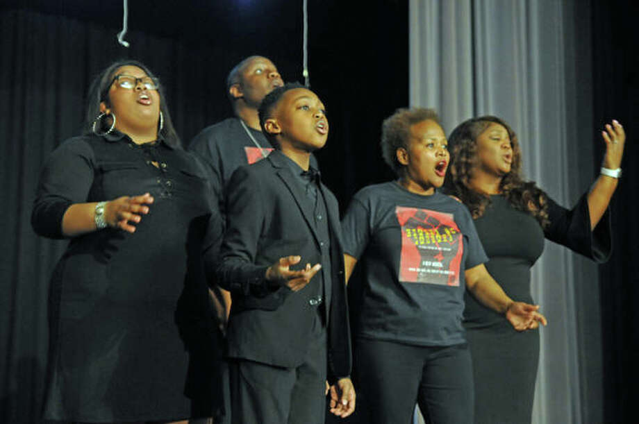 "The cast of ""Change to Passage"" performs Sunday at Alton Middle School, including 10-year-old Landon Page, left foreground. The new musical theater piece was showcased during an African American History Month program at the school."