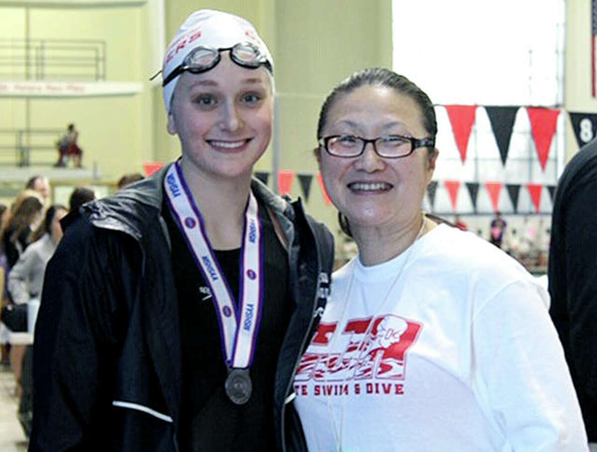 Anna Moehn of Alton, left, and her swim coach at Cor Jesu Academy of St. Louis, Qi Franz, at the Missouri State Girls High School Swim Championships at the St. Peters Rec Plex.