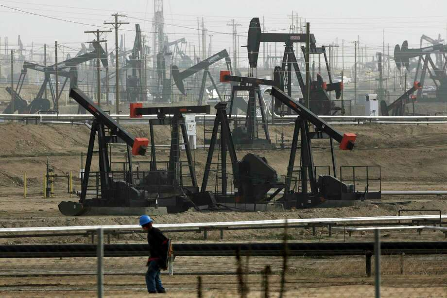Oil and gas companies have a trust problem, according to the authors. Photo: Jae C. Hong, STF / AP / Copyright 2016 The Associated Press. All rights reserved. This material may not be published, broadcast, rewritten or redistribu