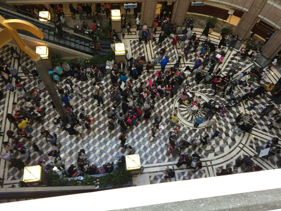 Thousands of opponents came to the Legislative Office Building Monday to protest a bill that would repeal the religious exemption from mandatory childhood vaccinations. Photo: Ken Dixon