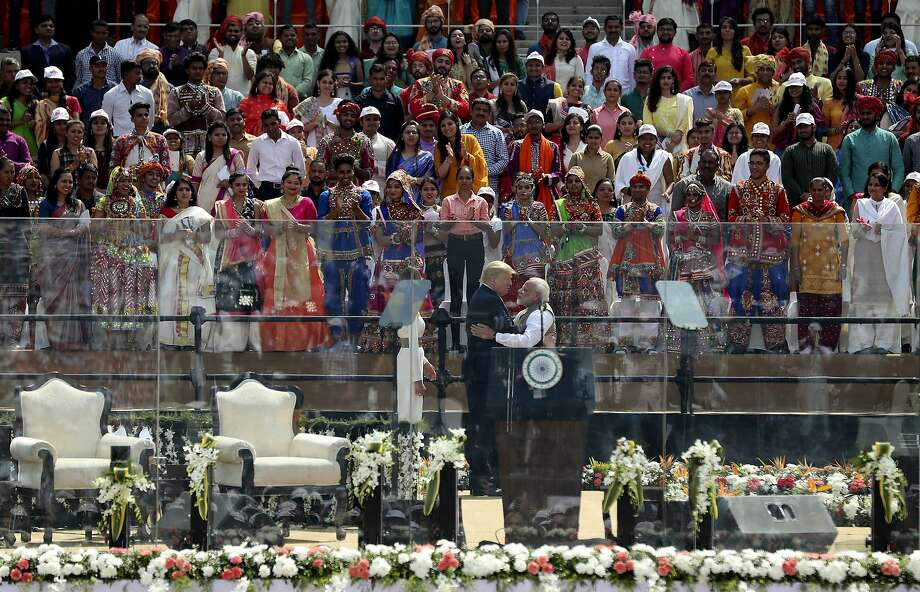 President Trump and Indian Prime Minister Narendra Modi hug at a packed stadium in Ahmedabad. Photo: Aijaz Rahi / Associated Press