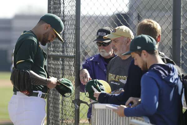 Oakland Athletics' Sean Manaea signs autographs for fans during spring training baseball practice, Thursday, Feb. 20, 2020, in Mesa, Ariz. (AP Photo/Darron Cummings)