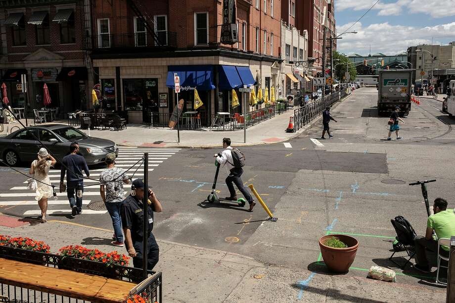 A man rides a Lime scooter in Hoboken, N.J. The San Francisco startup has closed operations in 12 cities. Photo: Bryan Anselm / New York Times 2019