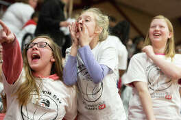 Local students cheer on the SIUE Women's Basketball team during a special Education Day event.