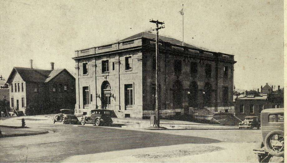 The current Manistee City Hall was originally constructed as the Manistee Post Office and is shown in this photograph from the 1920s.