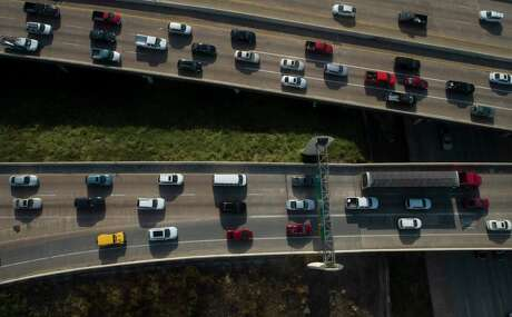 Houston drivers travel on Interstate 69 and Loop 610 in Uptown Houston on Aug. 21, 2019.