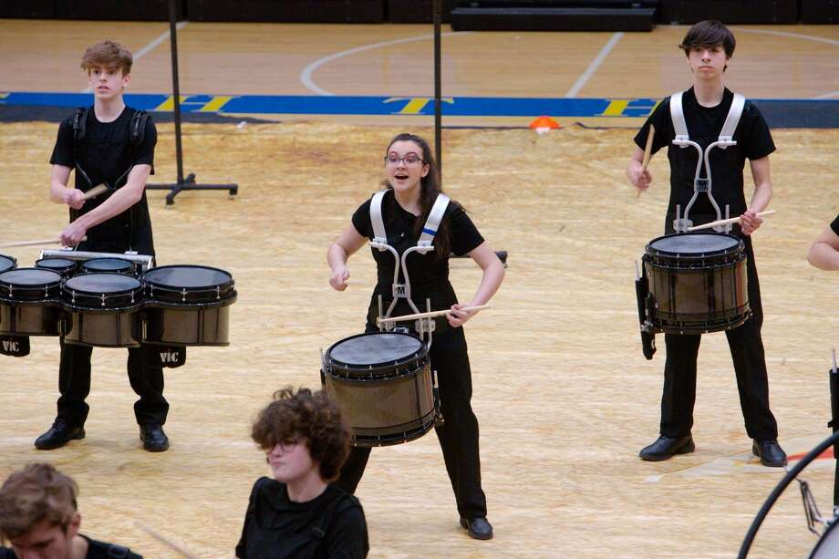 The Trumbull High School Winter Guard and Percussion ensembles performed at Newtown High School on Saturday, Feb. 22.  All three ensembles competed: Trumbull A Guard earned a second place finish with a score of 75.87; Trumbull World Guard finished in first place with a score of 83.20; and Trumbull Percussion Ensemble placed second with a score of 76.00. Photo: Contributed Photo