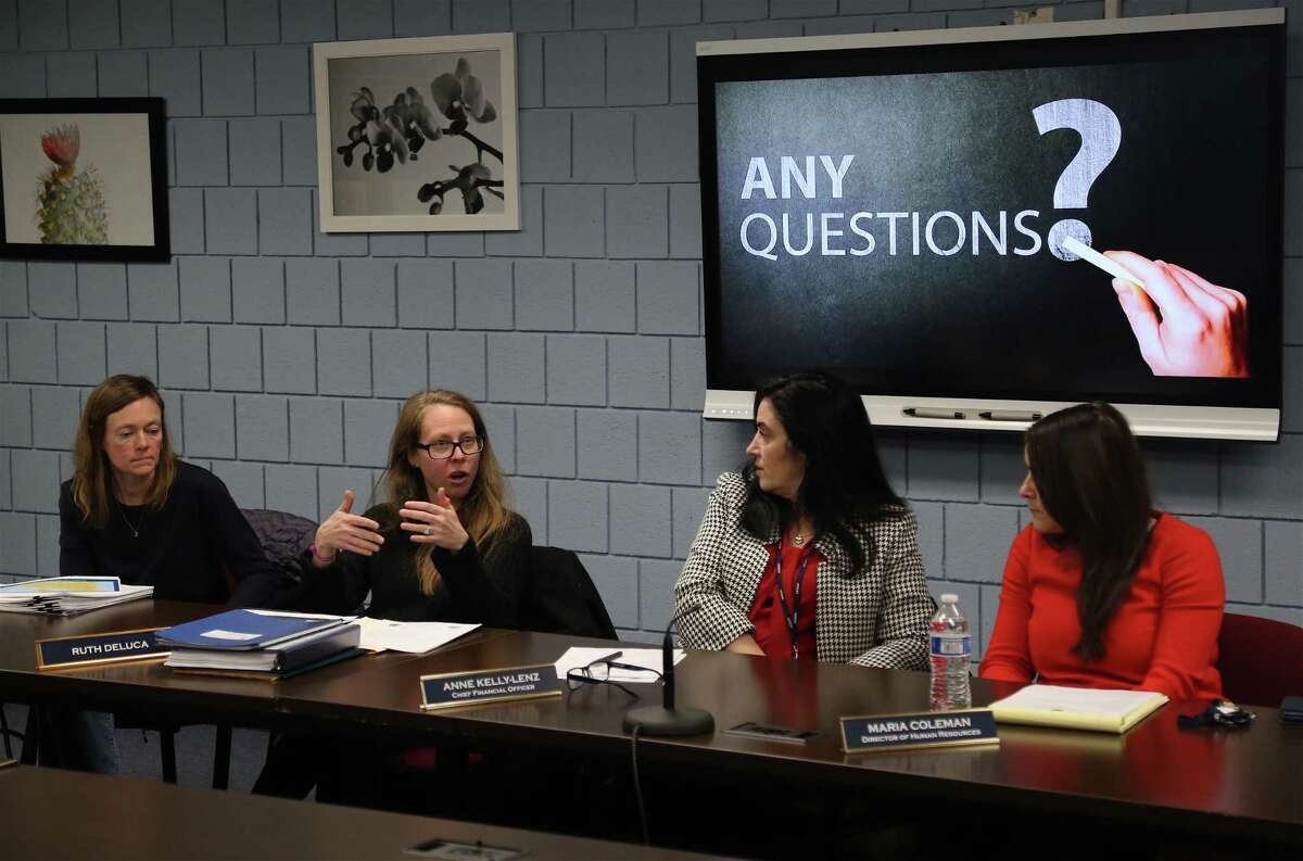 Board of Education member Ruth DeLuca, second from left, asks a question of Middlebrook School staff at a presentation on changing the school schedule.