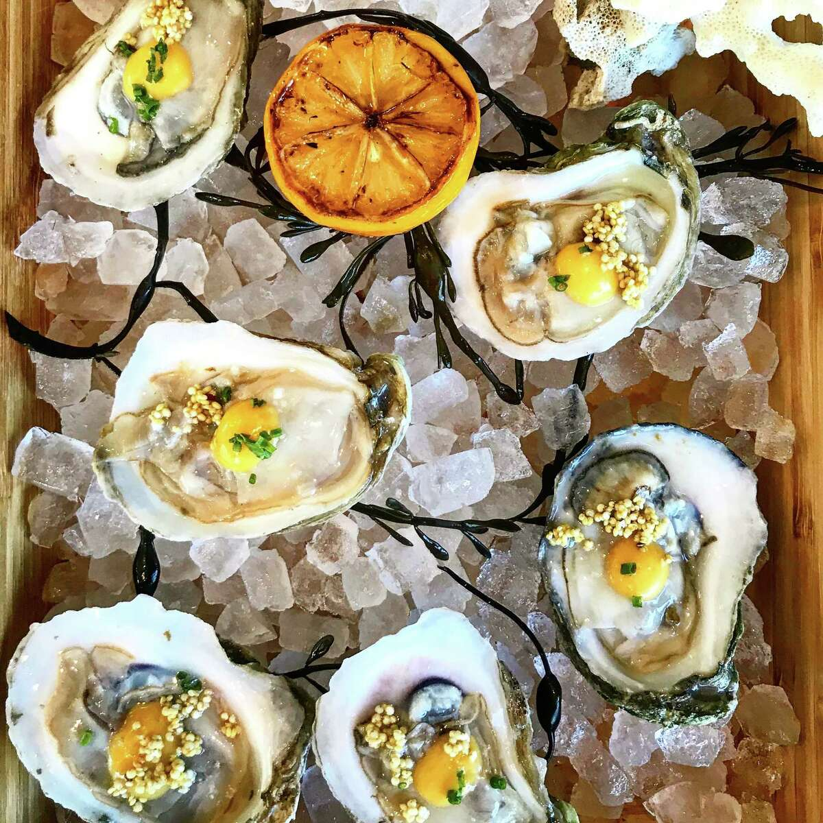 raw oysters with smoky chili mignonette at Alma restaurant in Highland Village.