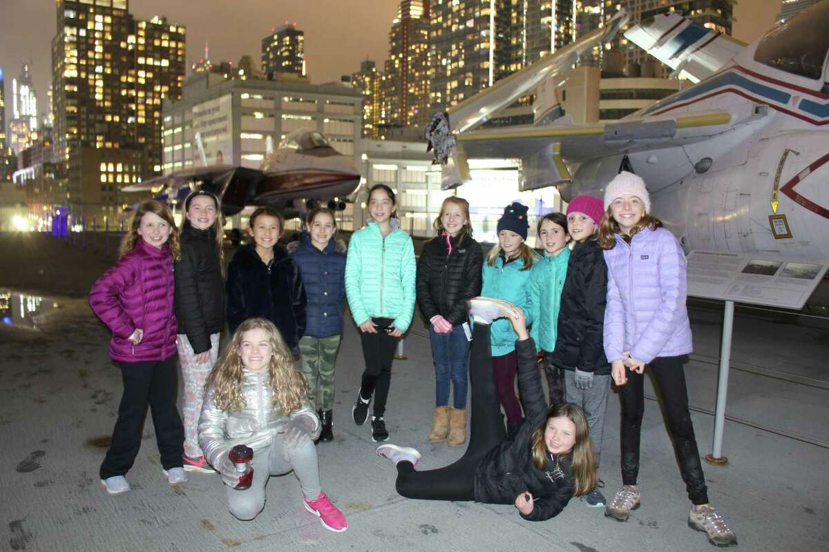 New Canaan Girl Scouts get a close look at aircraft on the Intrepid Sea, Air and Space Museum in New York City recently. In front are Olivia Barbera and Maya Lundberg. In back are Brenna Miller, Elle Culliss, Mis Ross, Lucy Casey, Sophie Dunlap, Katie Scholtz, Ellie Ikard, Ellie Whinery, Devin Boulanger and Abby Dunlap,