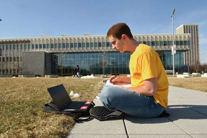 Sophomore business major Alex Schwalb of Jeffersonville, N.Y., studies outside on a warn sunny day at University at Albany on Monday, Feb. 24, 2020 in Albany, N.Y. Alex said