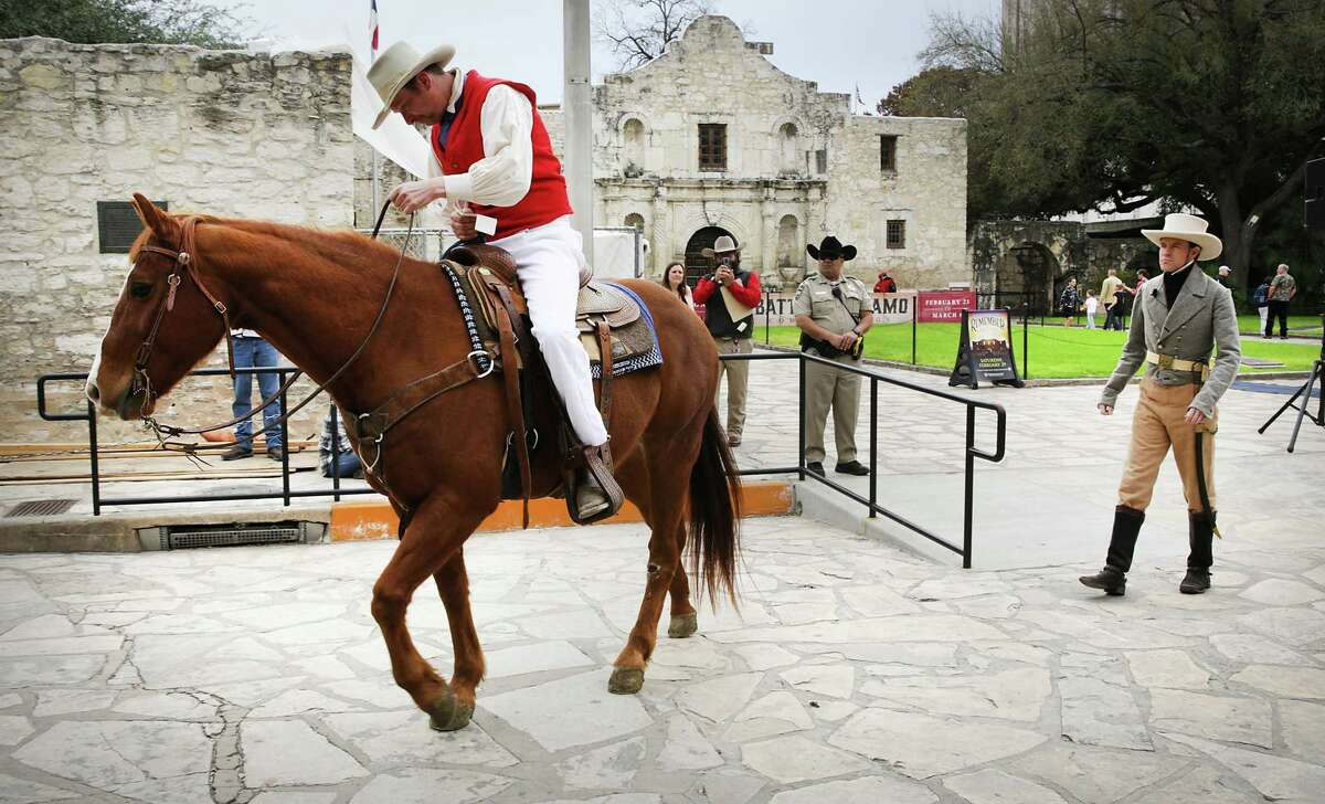 """Jake Metheny, left, portraying Albert Martin, rides off Monday morning after receiving William Barret Travis' famous """"victory or death"""" letter, from Erik McBroom, right, portraying Travis. The reenactment is part of the commemoration of the 13-day siege and Battle of the Alamo in 1836 that started with the arrival of the Mexican army under the leadership of Gen. Antonio López de Santa Anna."""