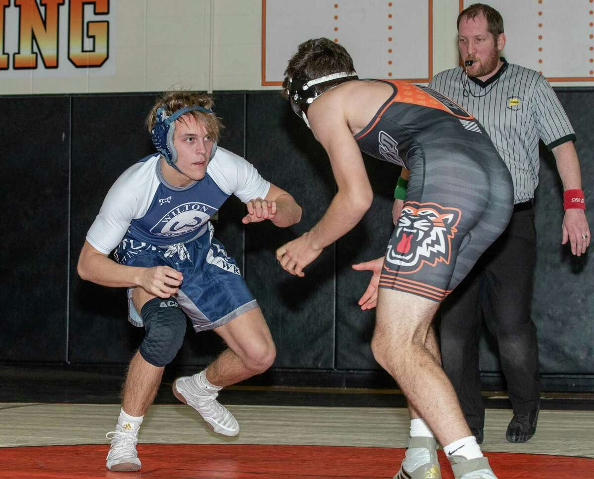 Quinton Kiss (left) was among the wrestlers who provided victories for Wilton at the Class L state tournament.