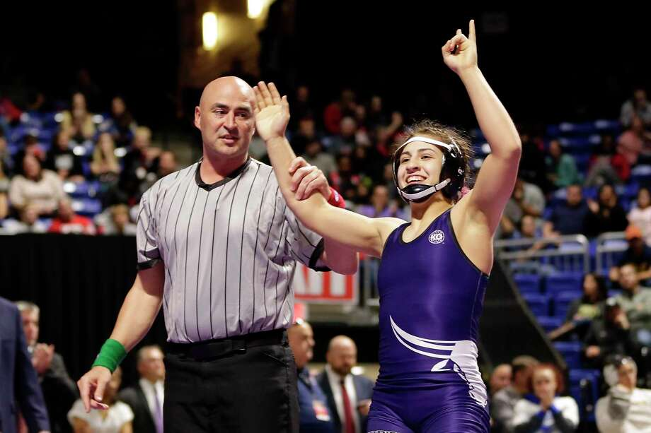 Morton Ranch's Jordan Suarez, right, is declared the winner in the Girls 6A-138lbs championship match of the state high school wrestling championships Saturday, Feb. 22, 2020 at the Berry Center in Cypress, TX. Photo: Michael Wyke / Contributor / © 2020 Houston Chronicle