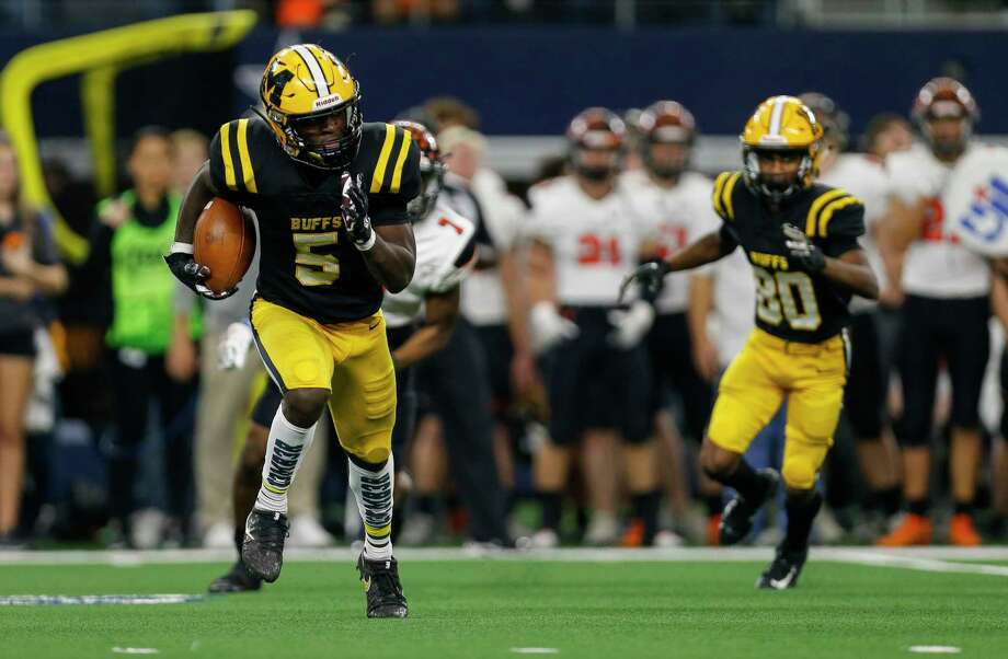 Fort Bend Marshall running back Devon Achane (5) runs the ball against Aledo during the third quarter of the UIL 5A Division 2 State Championship at AT&T Stadium Saturday, Dec. 21, 2019, in Arlington, Texas. Aledo won 45-42. Photo: Godofredo A. Vásquez, Houston Chronicle / Staff Photographer / © 2019 Houston Chronicle