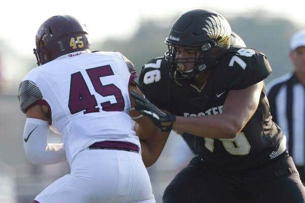 Foster guard Reuben Fatheree (76) blocks Magnolia West defensive linemen Jonathan Garcia (45) during the first quarter of a non-district high school football game at Guy K. Traylor Stadium, Saturday, Sept. 14, 2019, in Rosenberg.