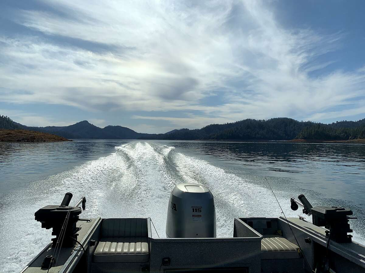 A clean wake across flat, calm water on a warm day at Shasta Lake gives rise to thoughts of spring for boating, camping and fishing