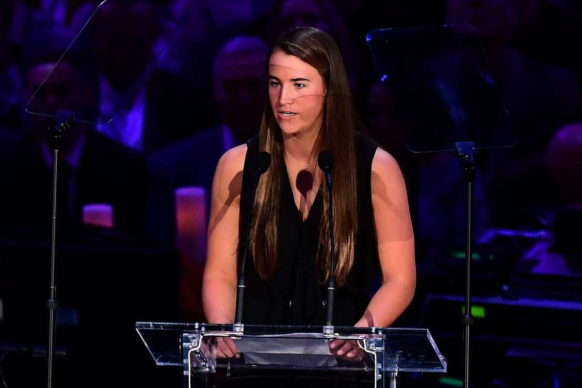 """US college basketball player Sabrina Ionescu speaks during the """"Celebration of Life for Kobe and Gianna Bryant"""" service at Staples Center in Downtown Los Angeles on February 24, 2020. - Kobe Bryant, 41, and 13-year-old Gianna were among nine people killed in a helicopter crash in the rugged hills west of Los Angeles on January 26. (Photo by Frederic J. BROWN / AFP) (Photo by FREDERIC J. BROWN/AFP via Getty Images)"""