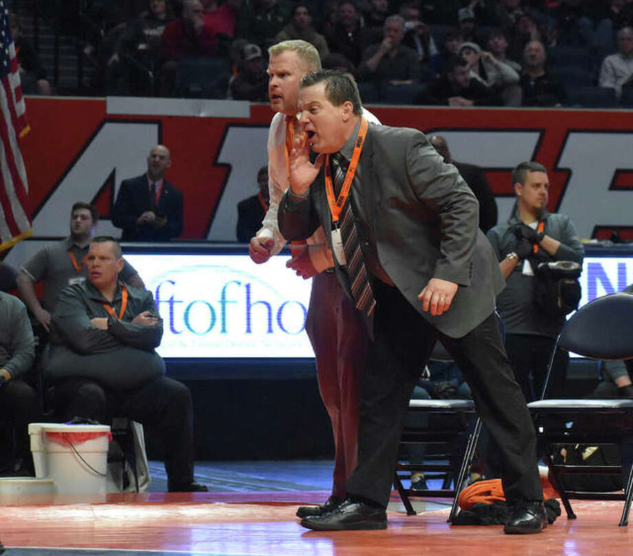 Edwardsville coach Jon Wagner, front, and assistant coach Doug Heinz shout out instructions during the 285-pound championship match at the Class 3A state tournament. Photo: Matt Kamp|The Intelligencer