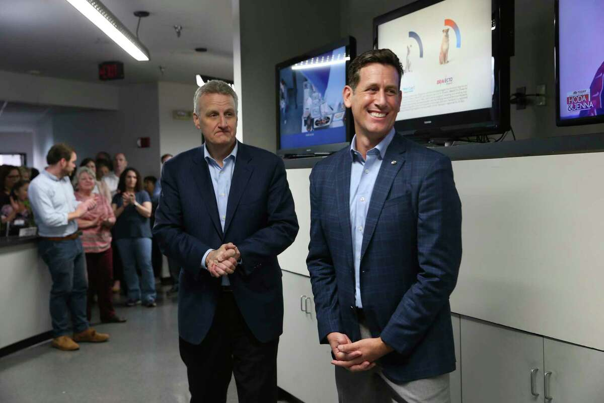 Houston Chronicle's President and Chief Marketing Officer Mark Medici, right, is named as the interim publisher of the San Antonio Express-News, Monday, Feb. 24, 2020. He spoke to employees after Hearst Newspaper President Jeff Johnson, left, introduced him.