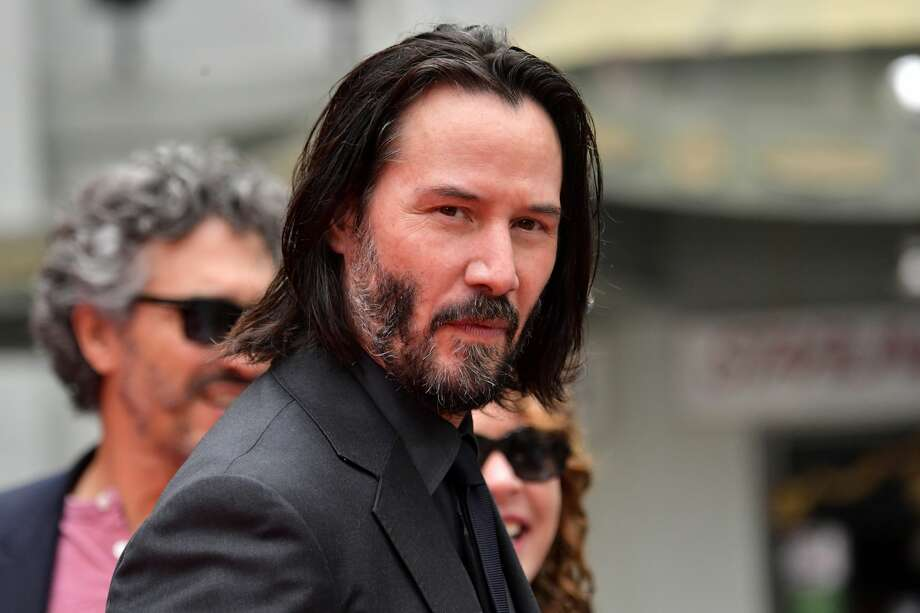 "Keanu Reeves arrives for his handprint ceremony at the TCL Chinese Theatre IMAX forecourt on May 14, 2019 in Hollywood.  As filming for ""Matrix 4"" continues, downtown SF residents have found themselves experiencing close encounters with shocking pyrotechnics and special effects. Photo: Emma McIntyre/Getty Images"