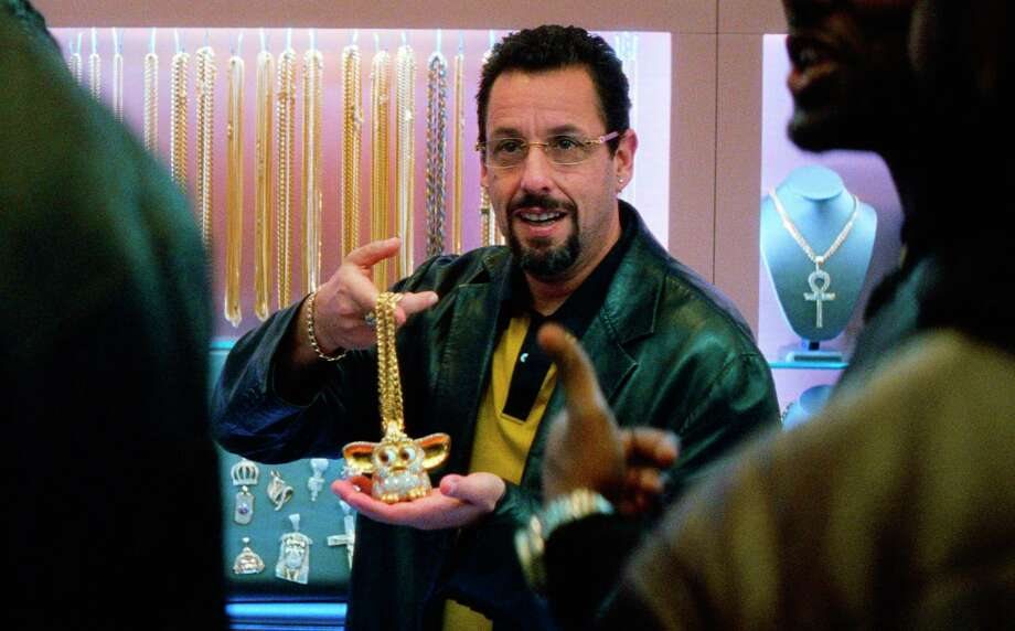 """Adam Sandler tries to seal the deal in """"Uncut Gems."""" Photo: A24 / A24"""