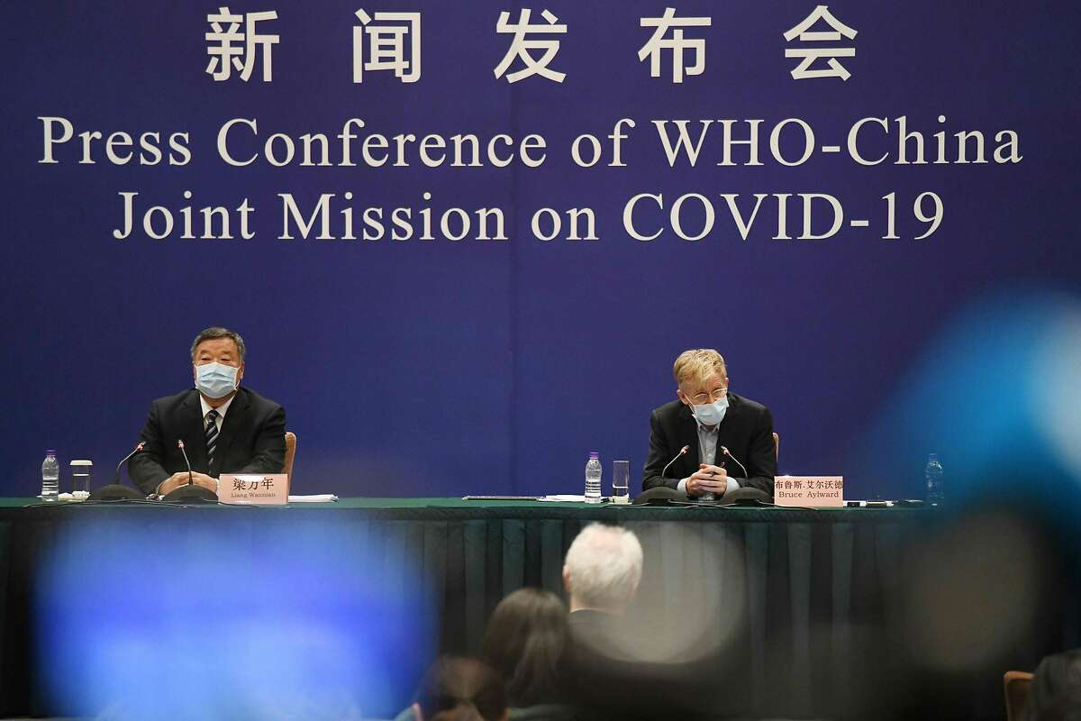 Bruce Aylward (R), head of the WHO-China Joint Mission on COVID-19 (R) speaks at a press conference about the COVID-19 coronavirus outbreak as Liang Wannian of China's National Health Commision looks on, in Beijing on February 24, 2020. - The novel coronavirus has spread to more than 25 countries since it emerged in December and is causing mounting alarm due to new outbreaks in Europe, the Middle East and Asia. (Photo by MATTHEW KNIGHT / AFP) (Photo by MATTHEW KNIGHT/AFP via Getty Images)