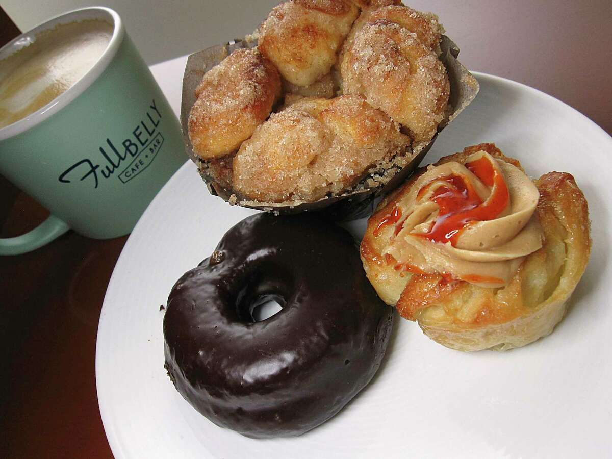 Baked goods made in-house include a chocolate doughnut, cinnamon-sugar monkey bread and a puff pastry with peanut butter cream filling and sriracha syrup at Full Belly Cafe and Bar.