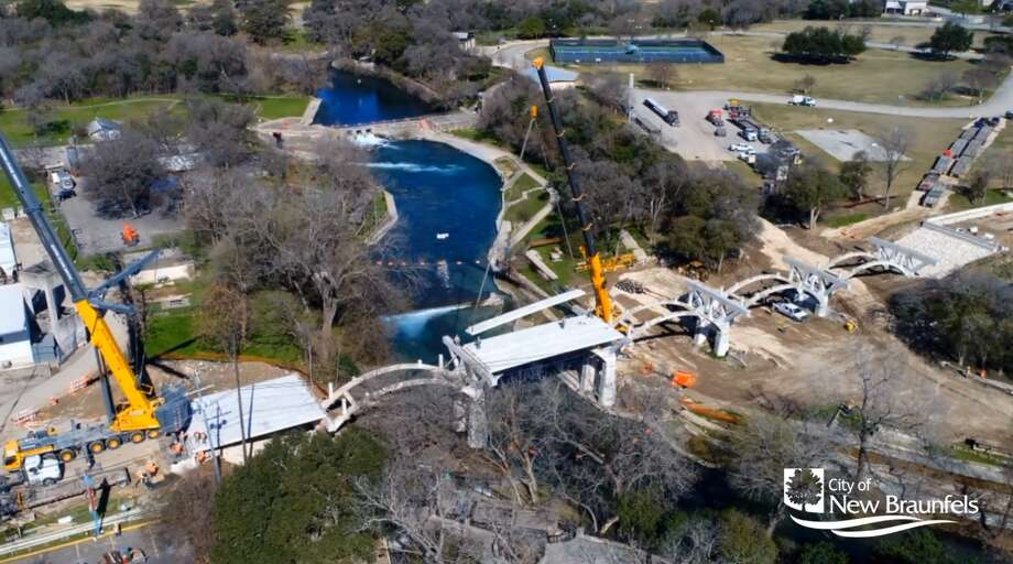 An aerial view shared by the City of New Braunfels on Feb. 21 shows parts of the bridge deck being installed by crane as the next phase of the $4.5 million project continues. Photo: Screenshot