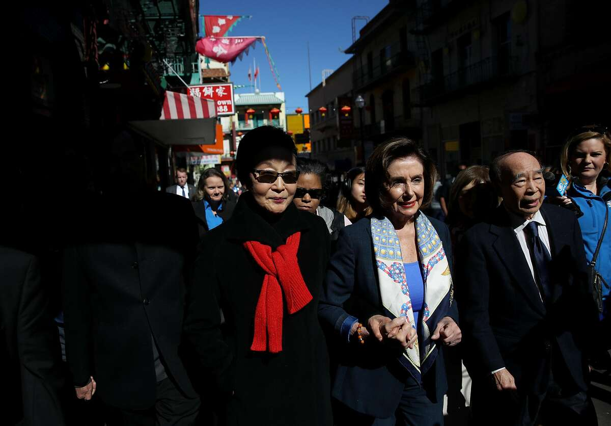 FILE PHOTO: House Speaker of the House Rep. Nancy Pelosi (D-Calif.), center, tours San Francisco's Chinatown on Feb. 24, 2020. Pelosi joined community leaders on a merchant walk and dim sum lunch in San Francisco's Chinatown as concerns over the coronavirus have had an impact on businesses in Chinatown.