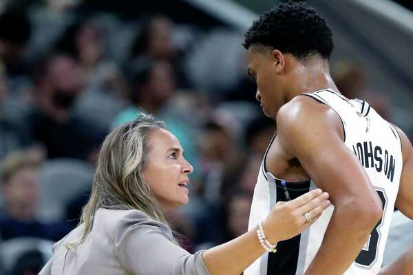 Coach Becky Hammon has some words to say to Keldon Johnson on the court as the Spurs host the Orlando Magic at the AT&T Center on Oct. 5, 2019.