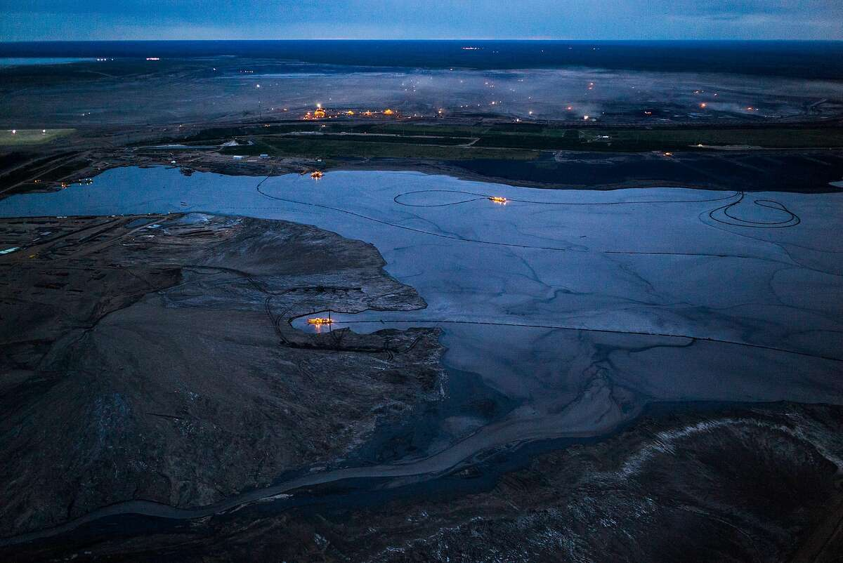 Chevron faces investor pressure to do more to curb emissions and fight climate change.