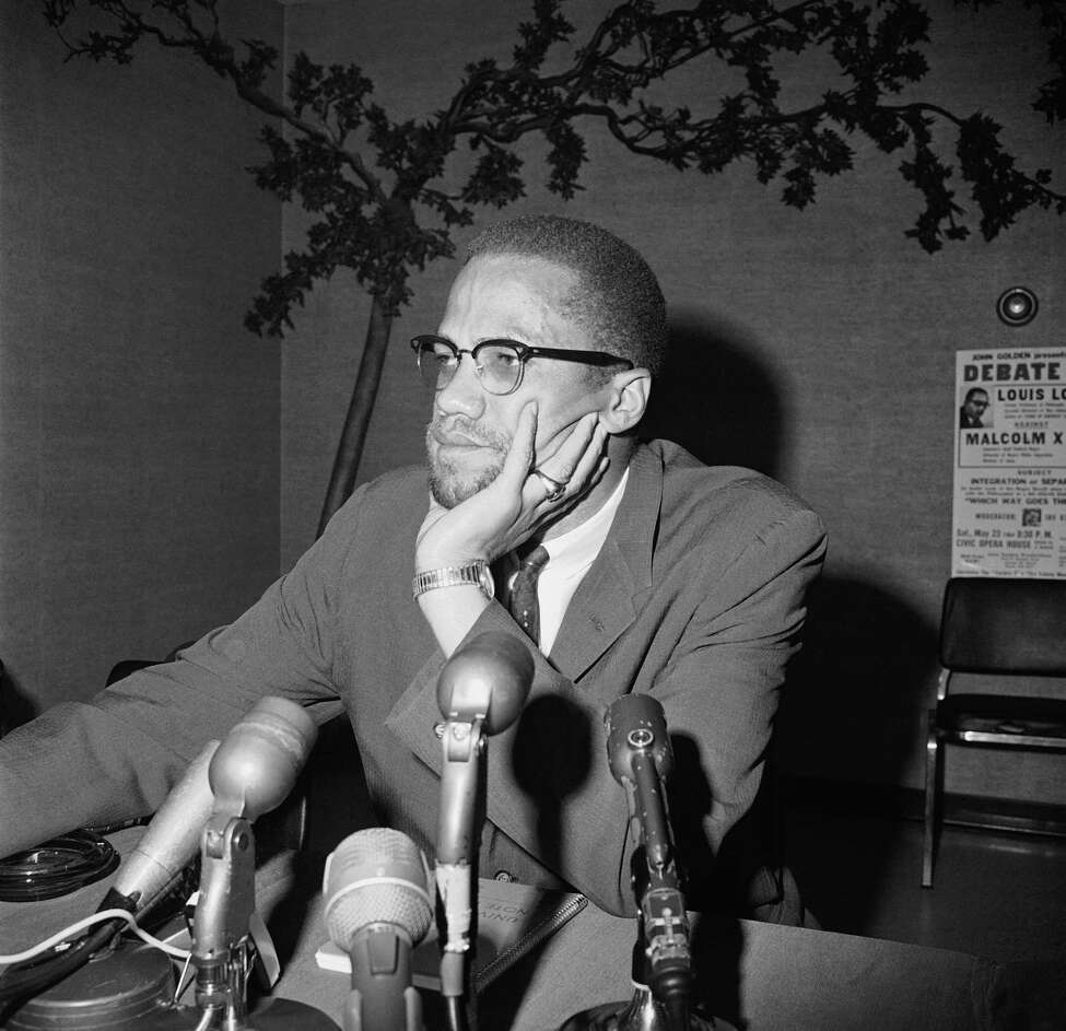 File - In this May 22, 1964, file photo, civil rights leader Malcolm X speaks during a press conference in Chicago.