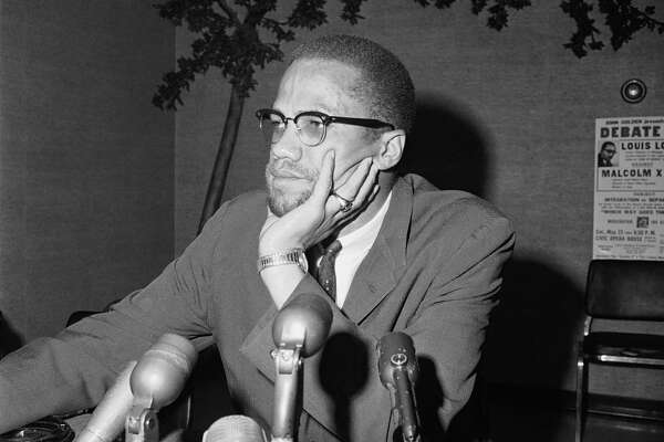 """File - In this May 22, 1964, file photo, civil rights leader Malcolm X speaks during a press conference in Chicago. """"Who Killed Malcolm X?"""" currently streaming on Netflix dives into questions surrounding his 1965 assassination and allegations of a botched investigation. (AP Photo/Edward Kitch, File)"""