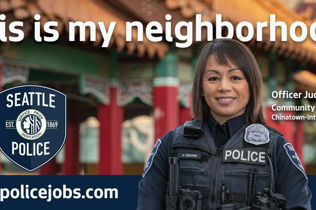 A photo of a billboard featured in the Seattle Police Department's new recruitment campaign.