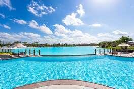"""A new """"crystal clear lagoon"""" planned for the Sierra Vista development in Rosharon, Texas will feature multiple white sand beaches, a splash pad, kids cove, swim-up bar and paddleboard and kayak options."""