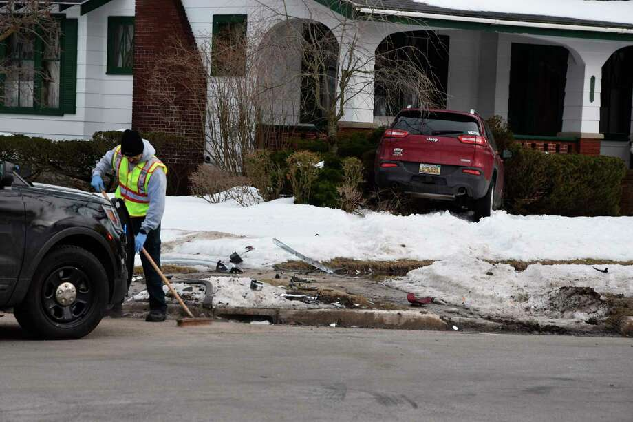 A Jeep Cherokee could be seen in the yard of a residence at the corner of Maple and Eighth streets after a crash Monday afternoon. Both vehicles involved were towed from the scene and crews could be seen sweeping debris and picking up pieces of the vehicles near the yard and street corner. (Arielle Breen/News Advocate)