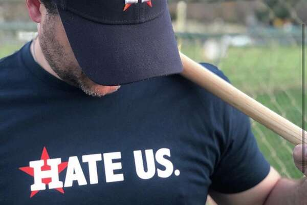 "Widely popular ""Hate Us"" shirt from creators Nick and Chelsea Drago."