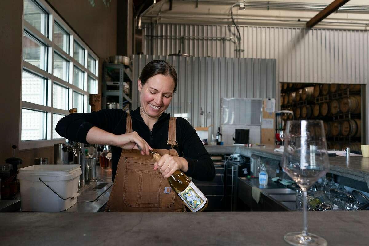 Martha Stoumen opens a bottle of wine where she works in Sebastopol, California.