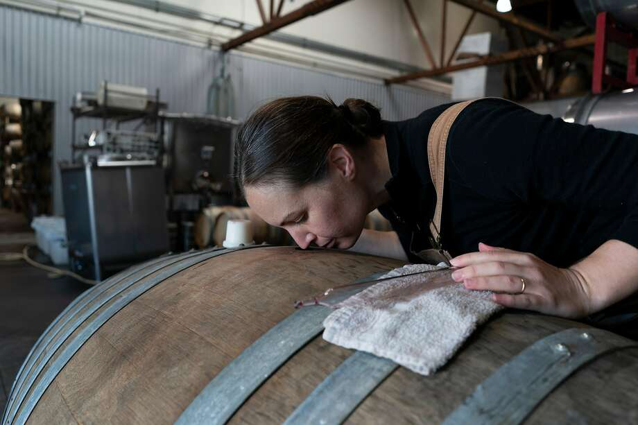 Martha Stoumen smells her wine out of a barrel. She identifies as a natural winemaker, which she says requires her to pay very close attention to her wines. Photo: Rachel Bujalski / Special To The Chronicle